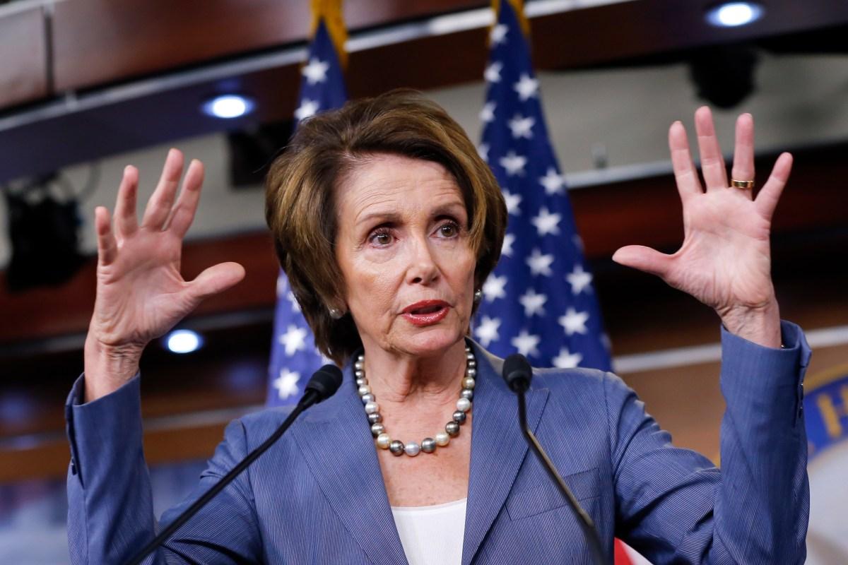 During a press conference, Nancy Pelosi called a top Trump adviser a white supremacist — twice