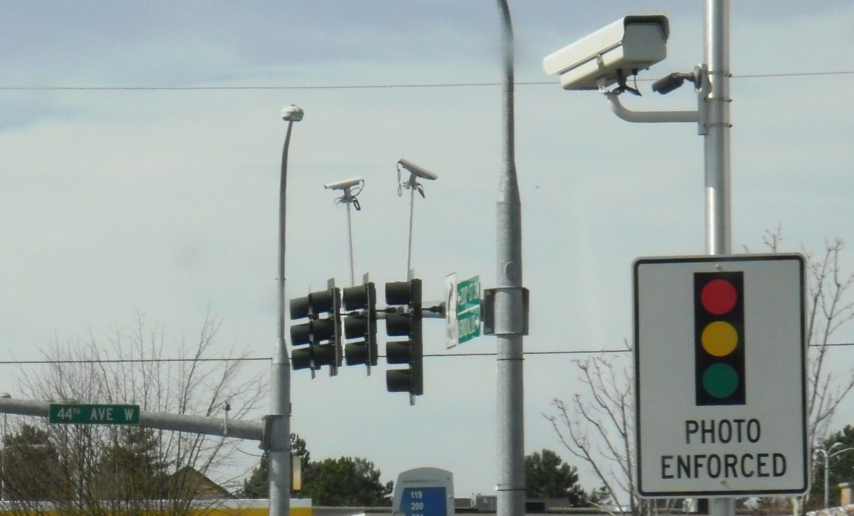 Raking in nearly $1 million this year, Sugar Land is cleaning up traffic with its red light cameras