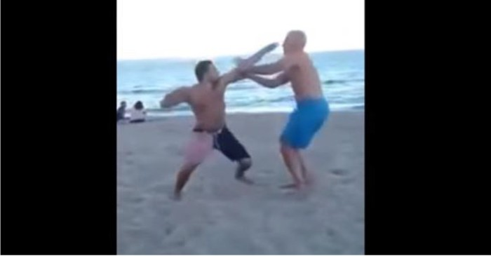 Dad completely knocks out drunk young punk on the beach for messing with his girls