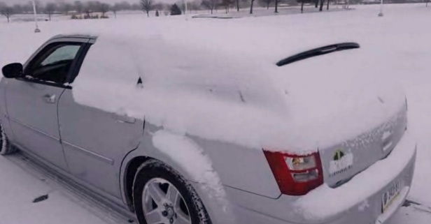Turn down for what? This guy has a badass way of getting snow off his car