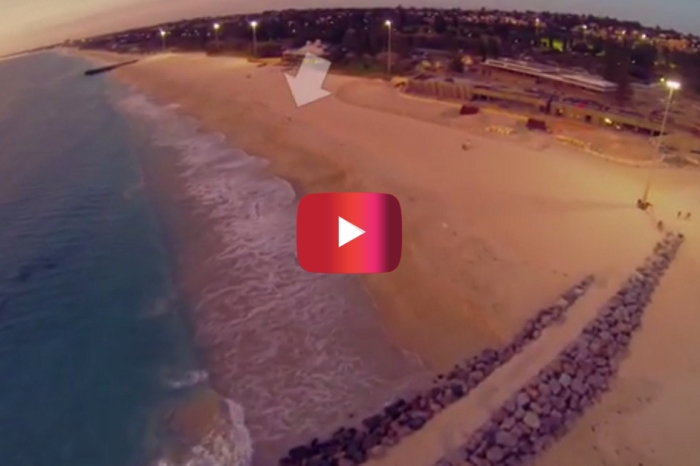 Watch this man sprint across the beach and rocks to save his powerless drone from falling into the water