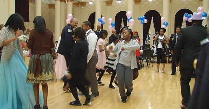 "These police officers step up to help girls without fathers at ""Daddy Daughter Dance"""