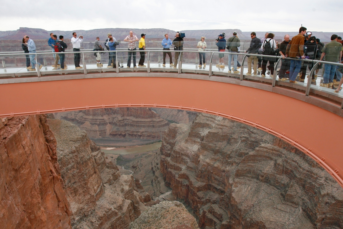 People walk on the Skywalk during the First Walk event at the Grand Canyon on the Hualapai Indian Reservation at Grand Canyon West, Ariz., Tuesday, March 20, 2007. The Skywalk opens to the general public on March 28. (AP Photo/Ross D. Franklin)