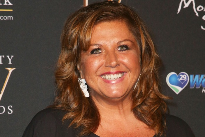 Abby Lee Miller shows off her newly slimmed-down figure in a post to fans from prison