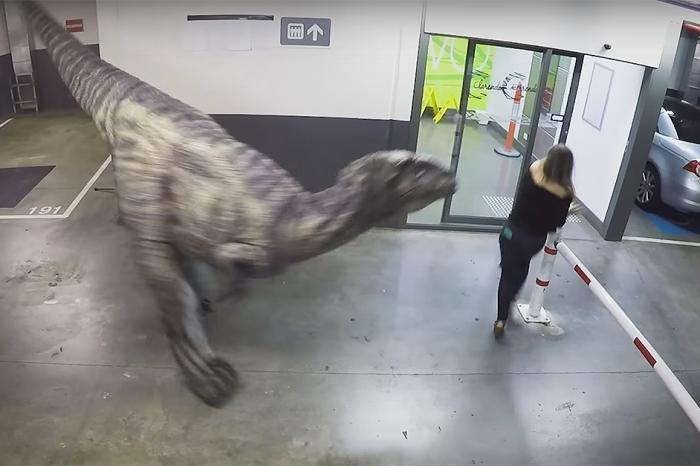 These guys pranked their co-workers with a lifelike dino and are probably going to hear from HR soon