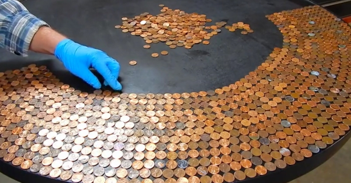 Watch as she tops an old table with $35 of pennies and glaze — the result is incredible!
