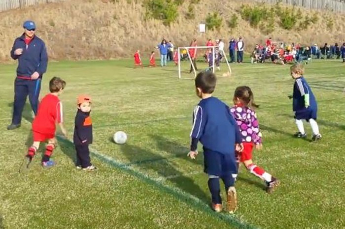 This little soccer player is all of us when we see our siblings cheering on the sideline