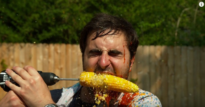 Guys eating corn off a drill in slow motion is totally gross