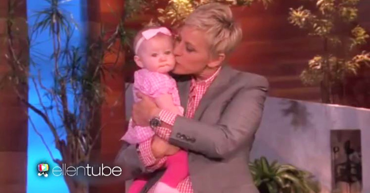 Ellen DeGeneres is holding this baby tight as she gives the girl a moment in the spotlight