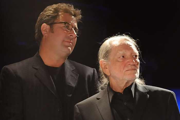 Vince Gill and Willie Nelson salute a dearly departed Country Music Hall of Fame member