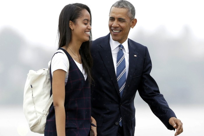 Barack and Michelle Obama spotted at Harvard University as they dropped off Malia for her first year
