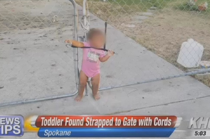 Man Finds Toddler Strapped to A Gate With a Bungee Cord