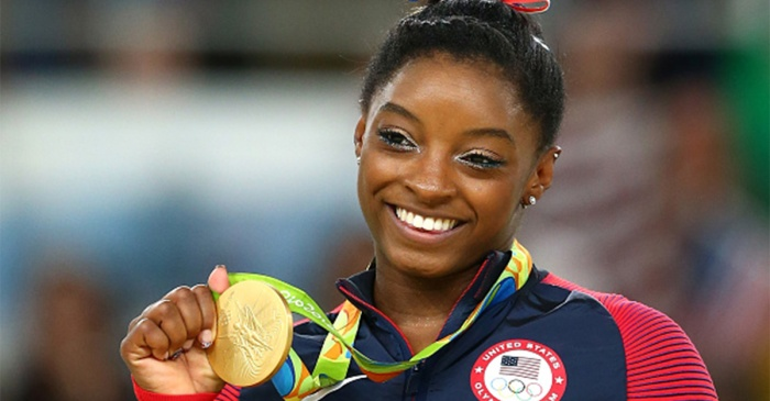 Simone Biles hopes to inspire other foster care kids to pursue their dreams in this very special way