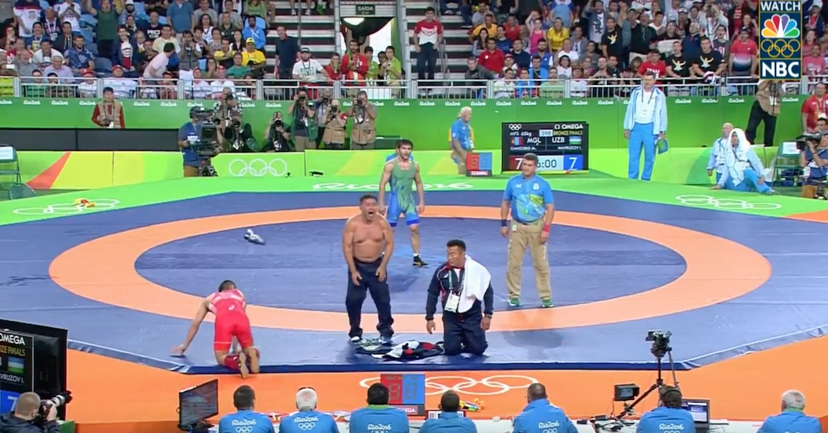 Mongolian wrestling coaches lost their shirts and their minds after losing on a controversial decision