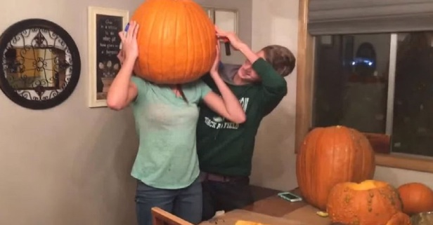 Curious Girl Gets Pumpkin Stuck on Her Head During Carving Session