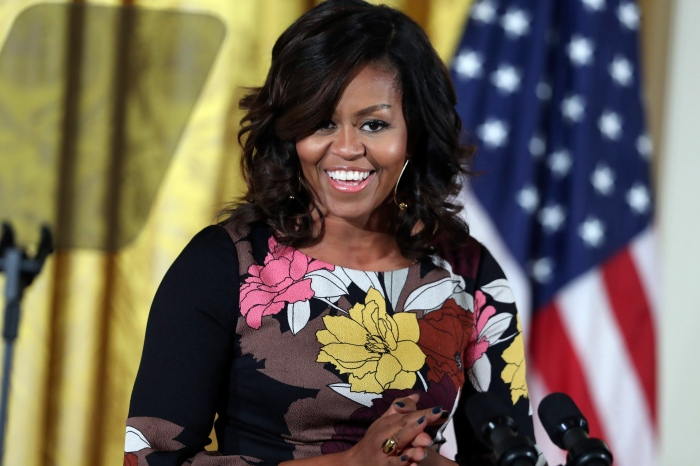 Michelle Obama tweets first message since leaving the White House and assures her followers she won't be gone long