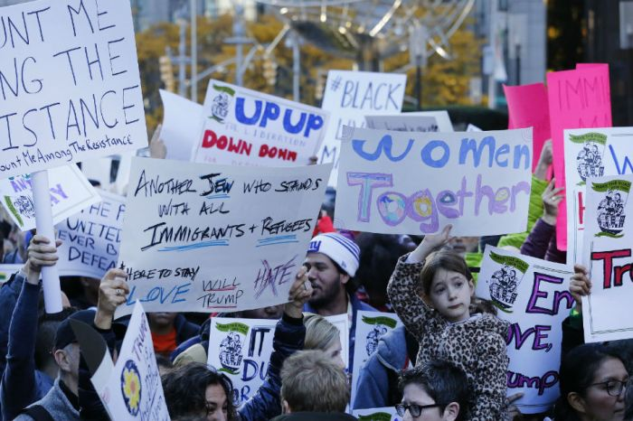 Hundreds march one day after Women's March in Anti-Trump Protest
