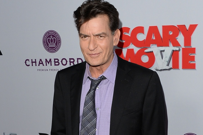 Charlie Sheen has a new girlfriend, and now she's weighing in on his HIV diagnosis