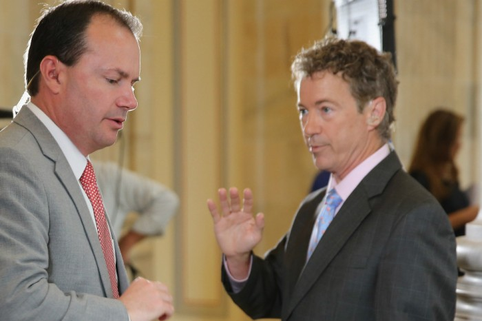 "Rand Paul and Mike Lee will vote ""no"" on spending bill if it reauthorizes warrantless surveillance"