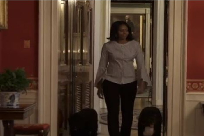 Michelle Obama shares a special moment as she takes one last walk through the White House with first dogs Bo and Sonny