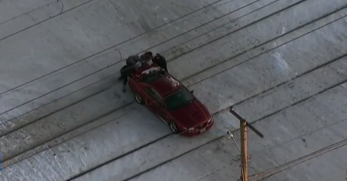 After a Mustang driver got stuck on train tracks, four people saved a life