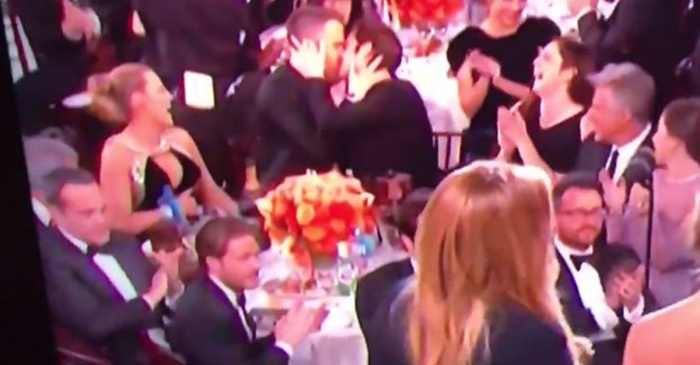 After losing to Ryan Gosling, Ryan Reynolds found comfort by planting a big kiss on Andrew Garfield