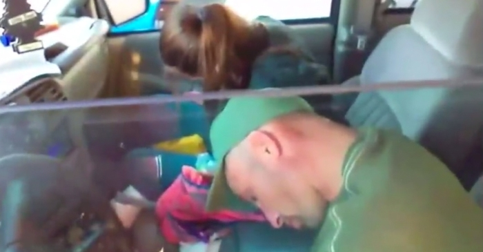 Horrifying video captures a couple who overdosed together and the little ones they left in the backseat