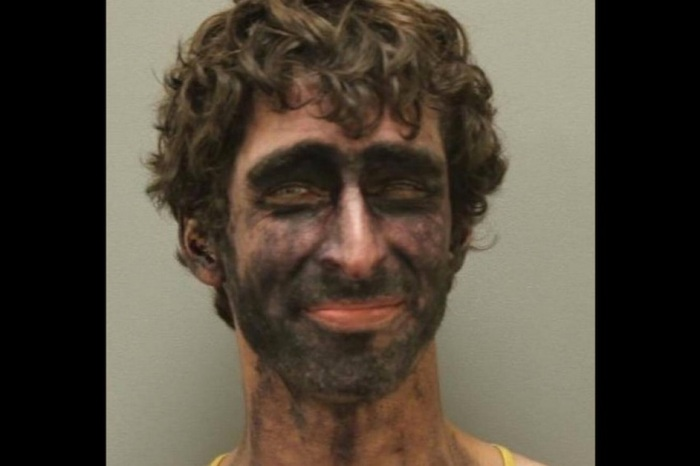 """Texas man who sprinted in and out of traffic and declared """"I am the law"""" ended his day with an unforgettable mugshot"""
