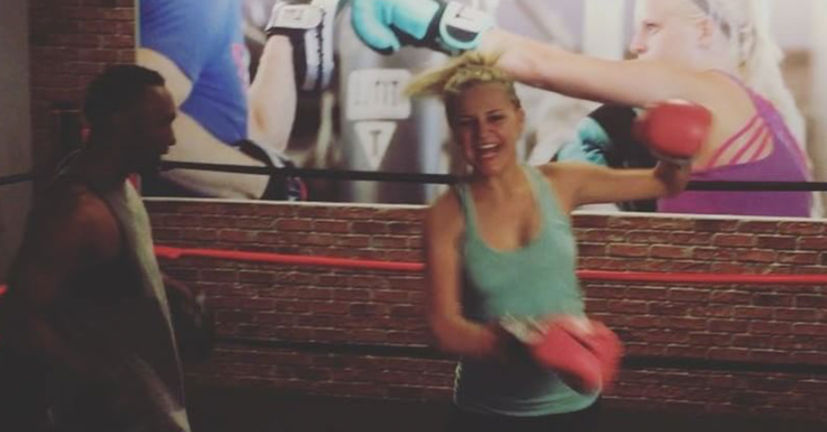 Kelsea Ballerini proves she can roll with the punches in this insane boxing video