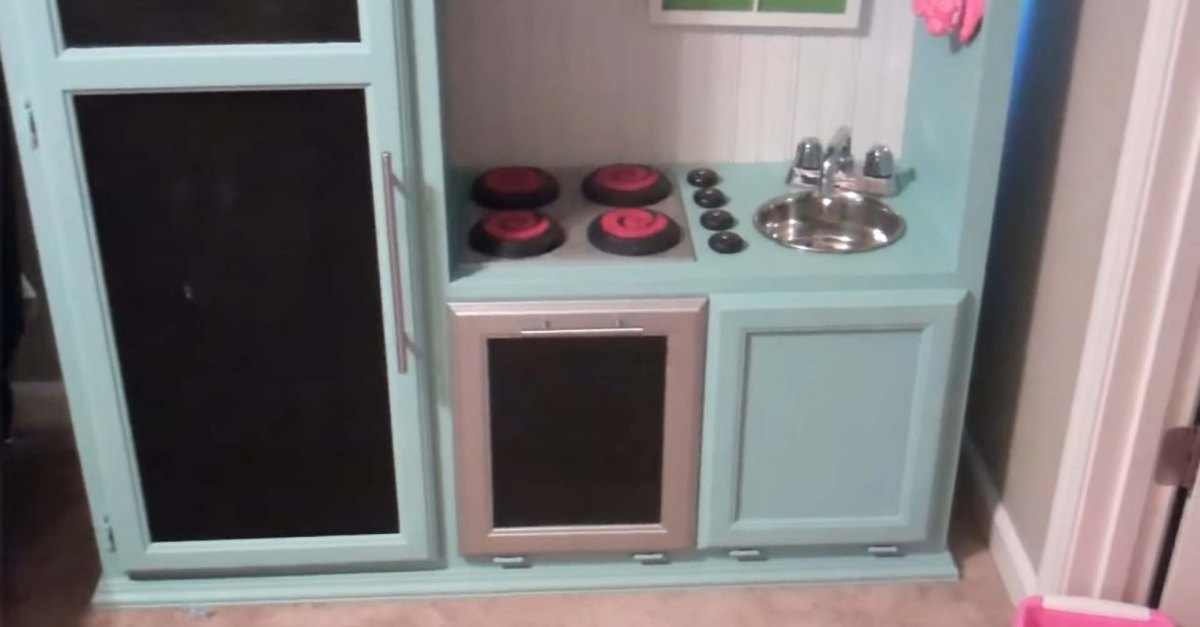 She transforms an old TV cabinent into a miniature kitchen that her kids love