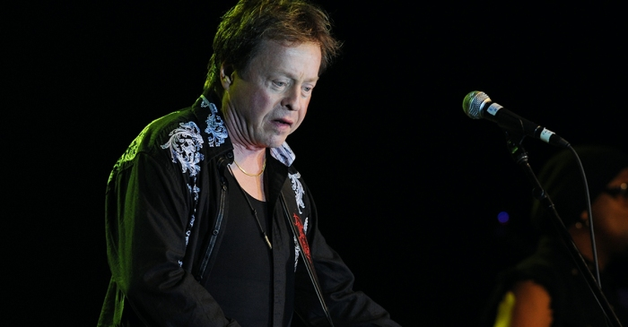 A music legend is in hot water after he was found with a gun on an airplane