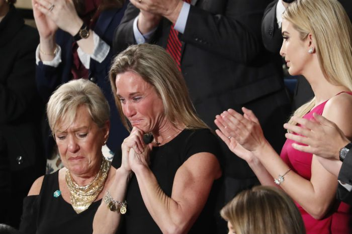 As the room stood and cheered, some politicians chose to sit when a military wife was honored