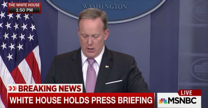 Sean Spicer had already begun his press briefing when people noticed an issue with his lapel pin