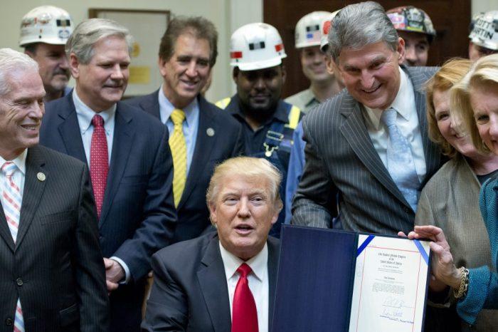 Trump signs executive order to slash environmental regulations, hoping to bring back mining jobs