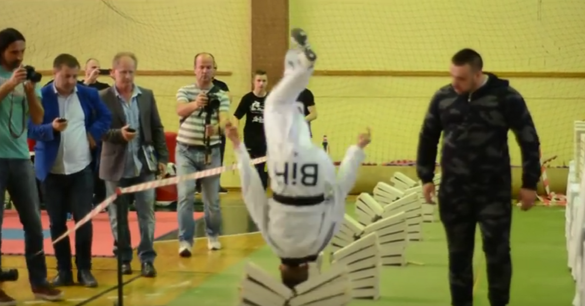 "Watch a teenage taekwondo champion smash 111 cement blocks with his head in ""Guinness World Records"" attempt"