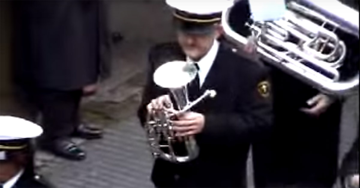 An ingenious prankster messed with a marching band by playing trumpet from his balcony