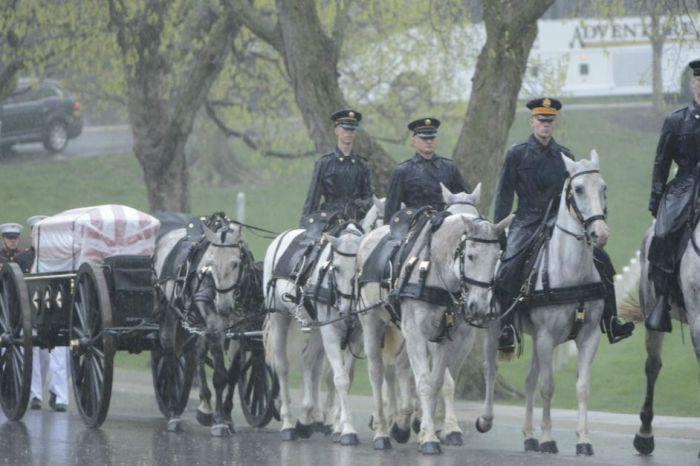 The rain descended peacefully as John Glenn was laid to rest in Arlington National Cemetery