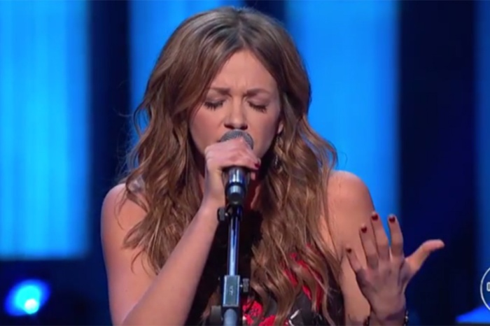 You can feel the spirits of the Opry when this country star shares her broken heart