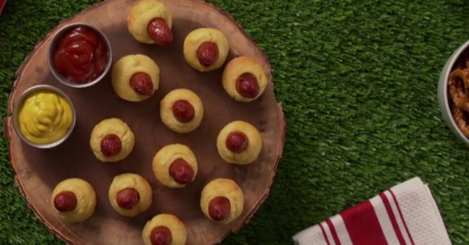 He sticks hot dogs in corn muffins for the coolest twist on corn dogs we've ever seen