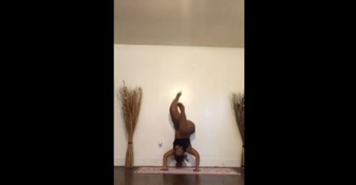 This aspiring yogi is trying to master the perfect headstand, but it winds up being one big fail