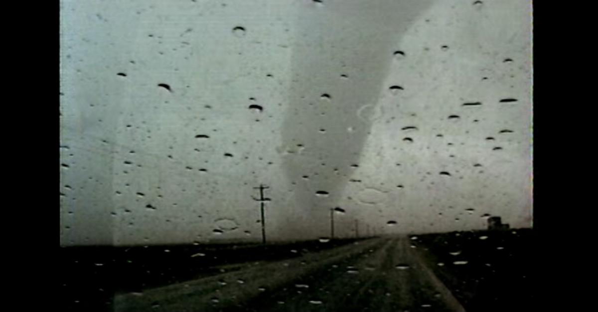 Watch this storm chaser embarrass himself after getting way too excited by a loud tornado