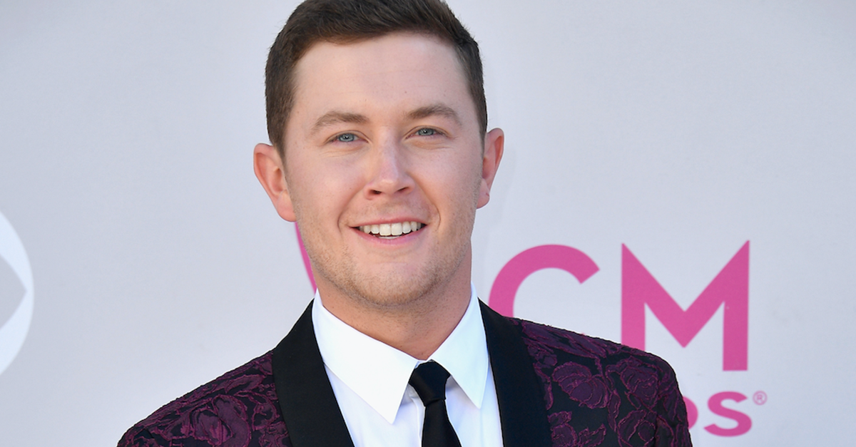Scotty McCreery tells us why his lovely lady, Gabi, had to skip the ACM Awards