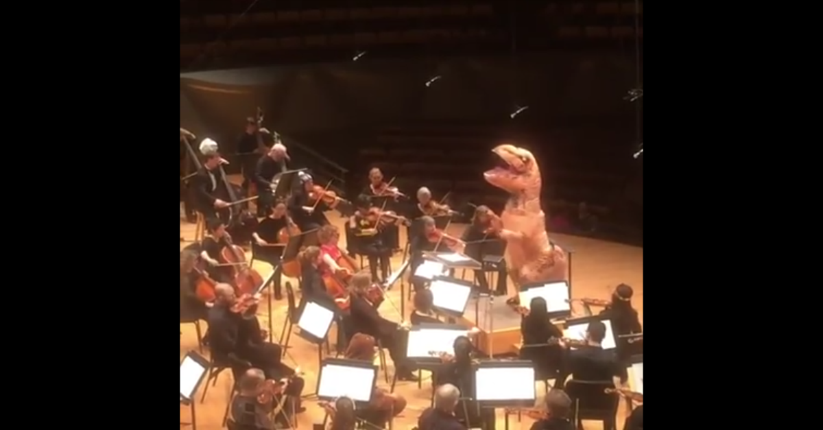 "This video of a t-rex conducting an orchestra will make ""Jurassic Park"" fans so nostalgic"