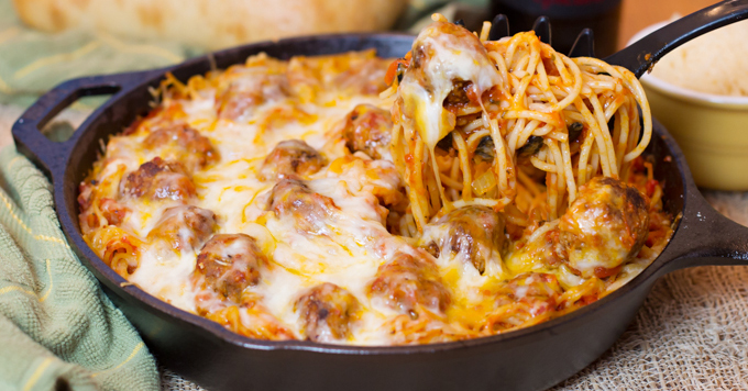 This cheesy spaghetti and meatball dish is baked in a skillet and we can't get enough