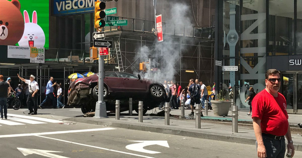 At least one person is reported dead after a car ripped through pedestrians in Times Square