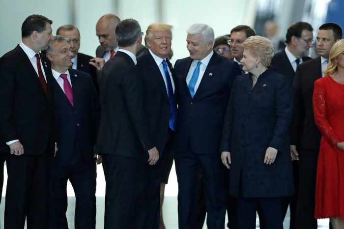 Out of my way! Trump appears to shove a prime minister as he makes his way to the front of the group
