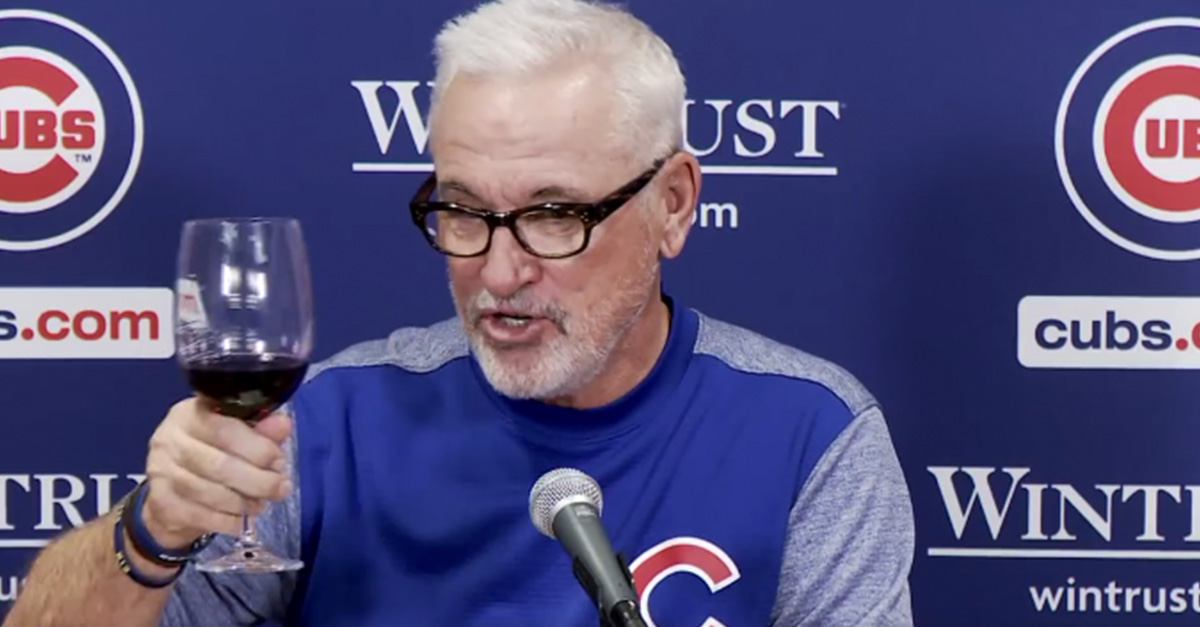 Cubs manager Joe Maddon toasts his 1,000 win with a fine glass of red wine
