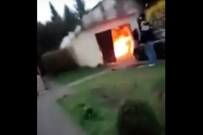 Watch what happens when you try to paint your garage with fireworks and spray paint