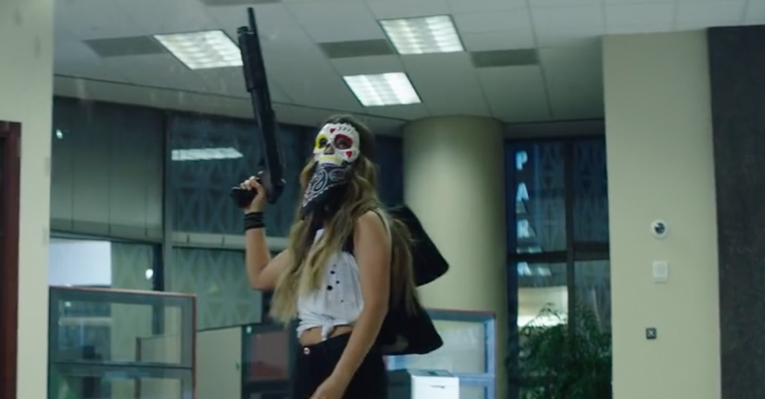A country darling shows off her dark side in this action-packed music video
