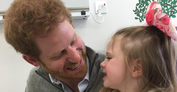 Prince Harry visited two terminally sick kids in the hospital and took some adorable photos